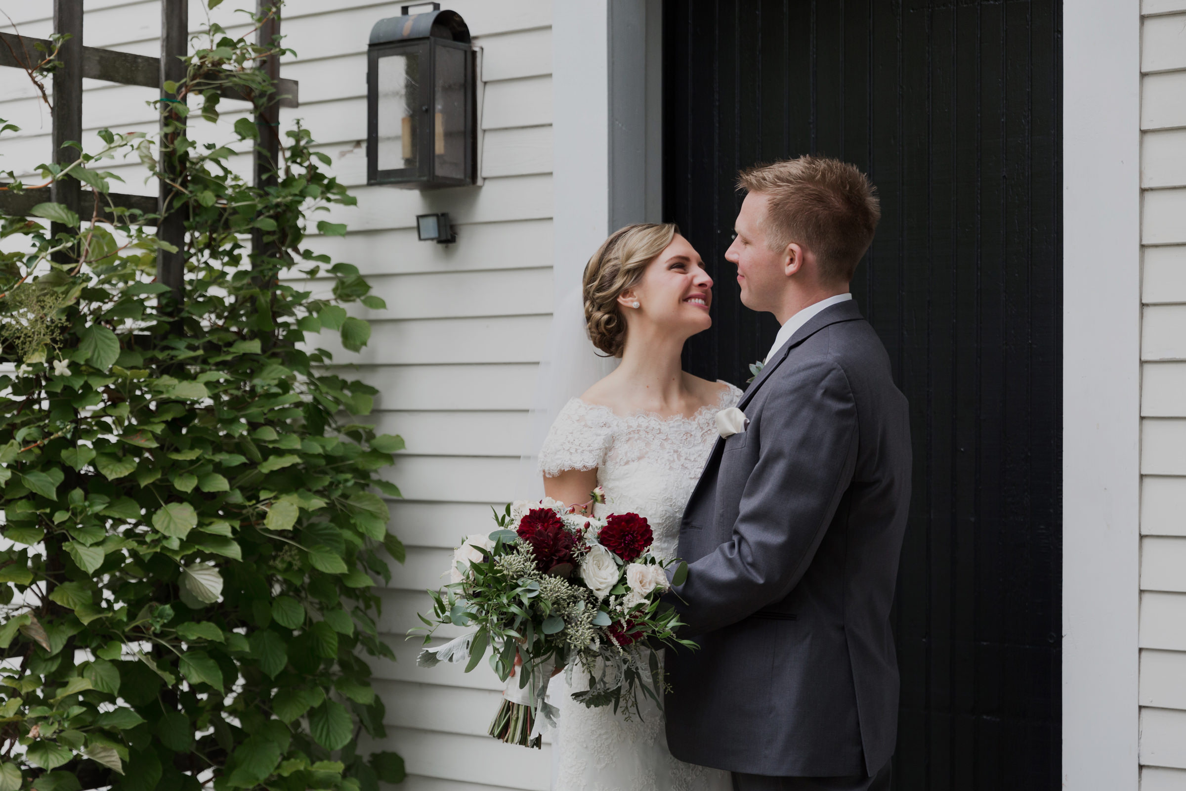 In front of The Barn on Walnut Hill on their wedding day